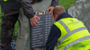 Fixing the plaques on the stones in the Memorial Gardens